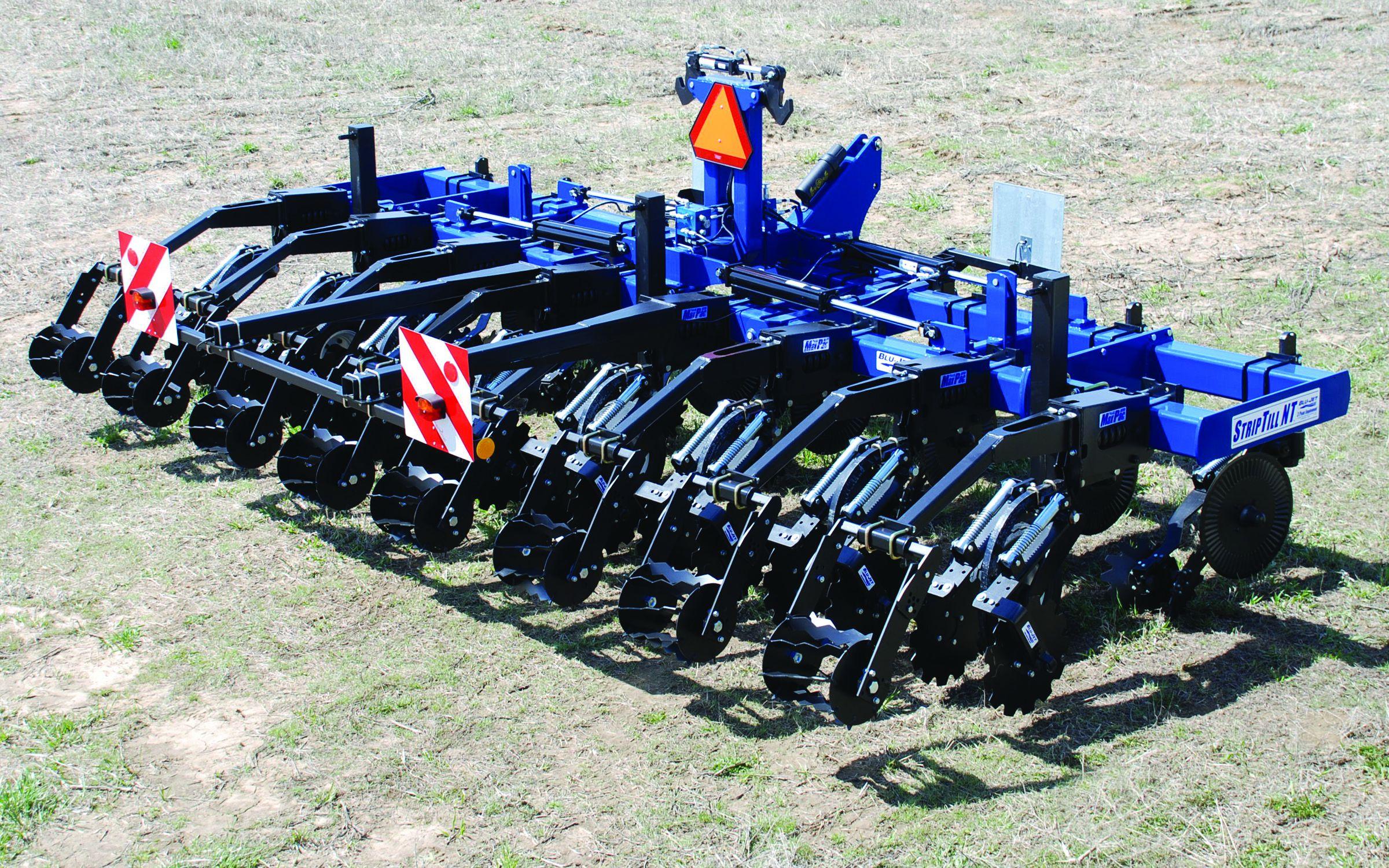 Навісний агрегат для смугового обробітку ґрунту зі зменшеною транспортною шириною